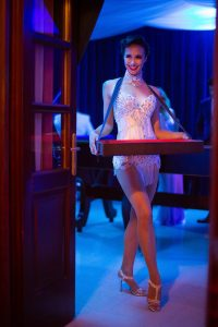 Casino lady at Casino Royale-themed party at this Aman Sveti Stefan Montenegro destination wedding weekend | Photo by Allan Zepeda