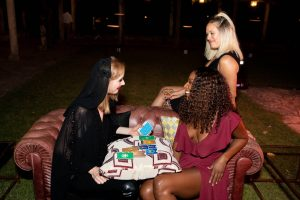 Fortune teller at Casino Royale-themed party at this Aman Sveti Stefan Montenegro destination wedding weekend | Photo by Allan Zepeda