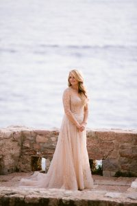 Bride during first look at this Aman Sveti Stefan Montenegro destination wedding weekend | Photo by Allan Zepeda