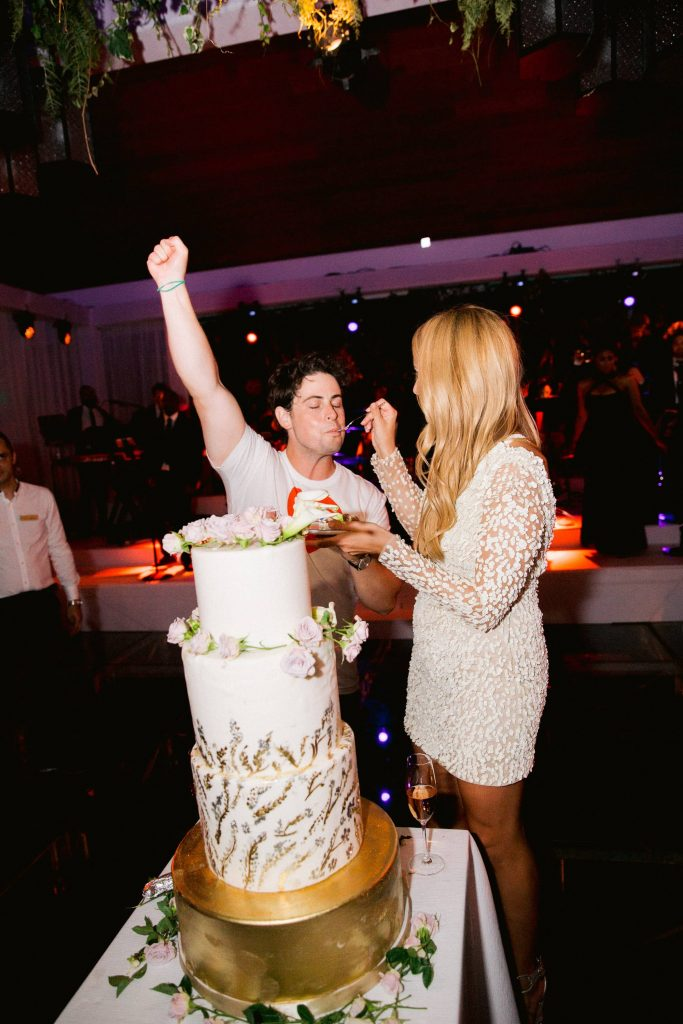 Cake cutting during reception at this Aman Sveti Stefan Montenegro destination wedding weekend | Photo by Allan Zepeda