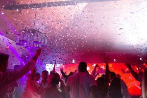 After party confetti and dancing at this Aman Sveti Stefan Montenegro destination wedding weekend | Photo by Allan Zepeda