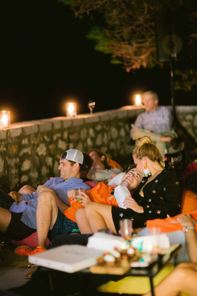 Movie night at Cliffside pool at this Aman Sveti Stefan Montenegro destination wedding weekend | Photo by Allan Zepeda