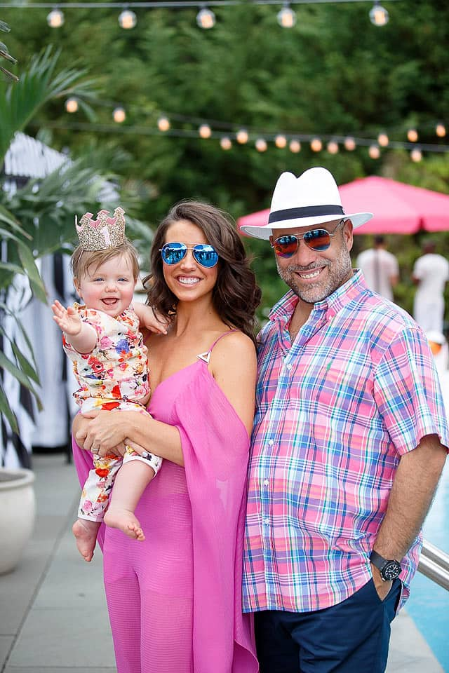 Parents and baby at this South Beach-inspired first birthday pool party in the Hamptons | Photo by Cava Photo