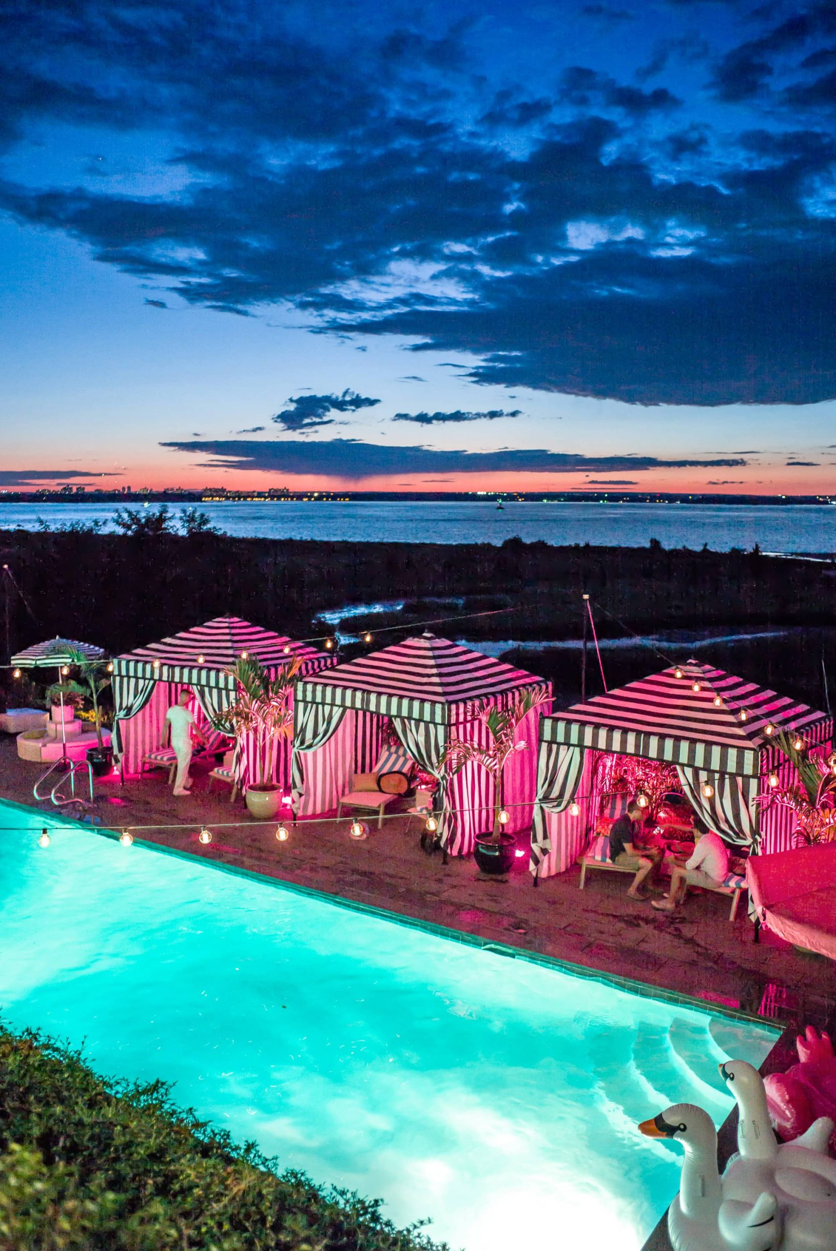 Saint Tropez with pink lightsat this first birthday pool party in the Hamptons | Photo by Cava Photo