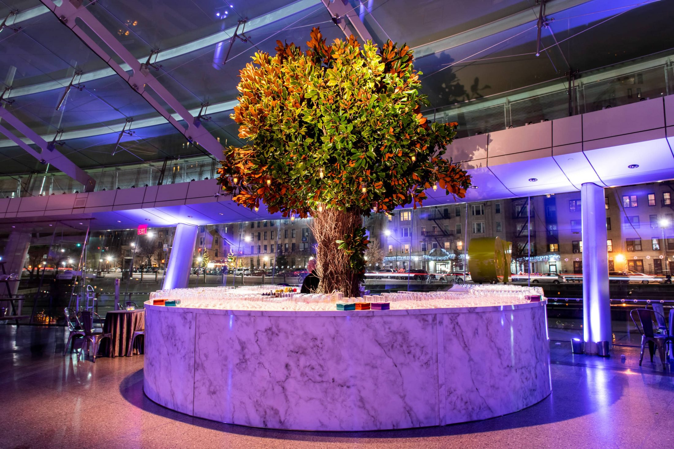 Giant floral design at drink station at this Brooklyn Museum rehearsal dinner in NYC | Photo by Gruber Photo