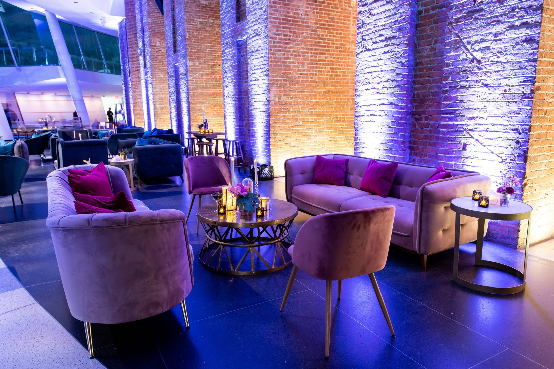 Purple velvet couches in lounge area at this Brooklyn Museum rehearsal dinner in NYC | Photo by Gruber Photo