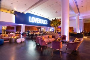 Love Rules sign overlooking lounge area at this Brooklyn Museum rehearsal dinner in NYC | Photo by Gruber Photo