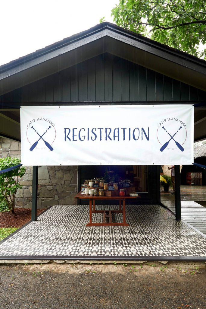 Field day registration at this camp-themed wedding weekend at Cedar Lakes Estate in Upstate NY, USA | Photo by Christian Oth Studios