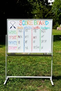 Field day scoreboard at this camp-themed wedding weekend at Cedar Lakes Estate in Upstate NY, USA | Photo by Christian Oth Studios