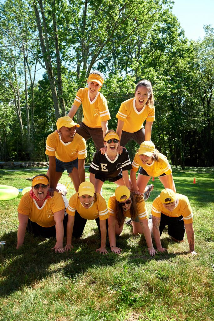 Yellow team pyramid at field day at this camp-themed wedding weekend at Cedar Lakes Estate in Upstate NY, USA | Photo by Christian Oth Studios