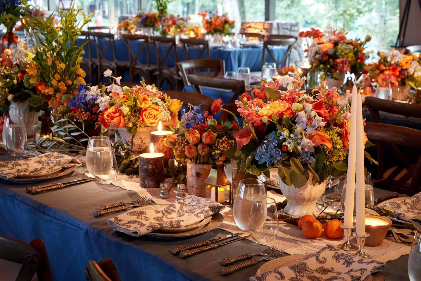 Rustic floral and table decor for the welcome party at this camp-themed wedding weekend at Cedar Lakes Estate in Upstate NY, USA | Photo by Christian Oth Studios