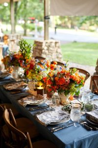 Welcome party table decor at this camp-themed wedding weekend at Cedar Lakes Estate in Upstate NY, USA | Photo by Christian Oth Studios
