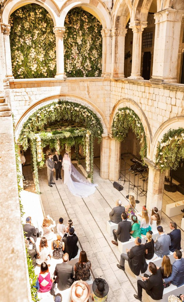 Ceremony decorated with peonies, jasmine, and tuberose by Theirry Boutemy at Palača Sponza at this Dubrovnik Wedding in Croatia | Photo by Robert Fairer