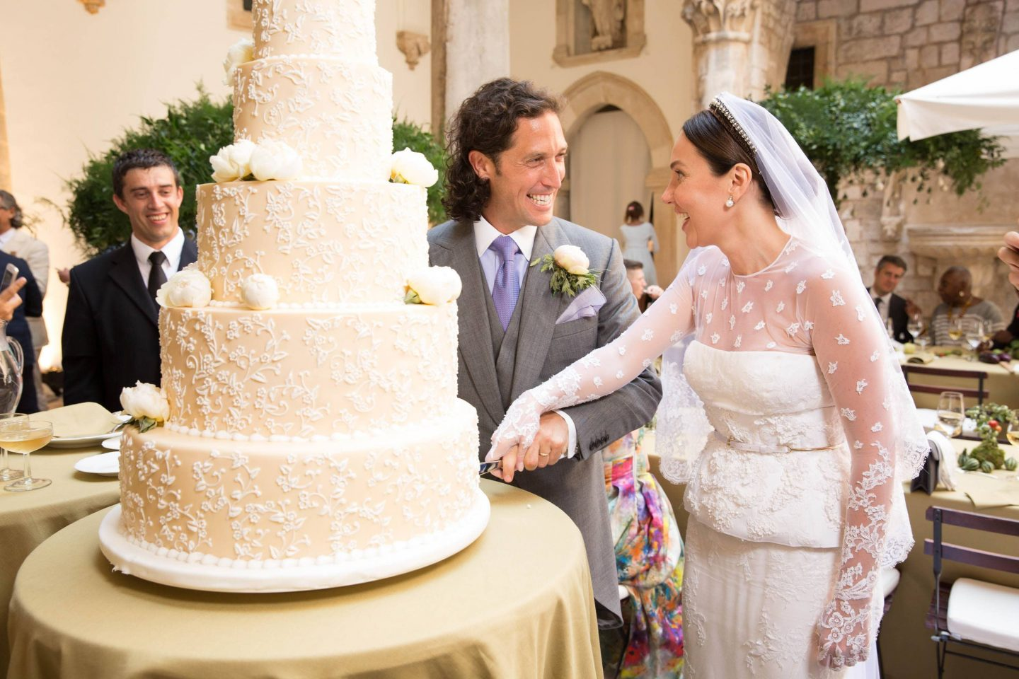 Cake cutting at this Dubrovnik Wedding in Croatia | Photo by Robert Fairer