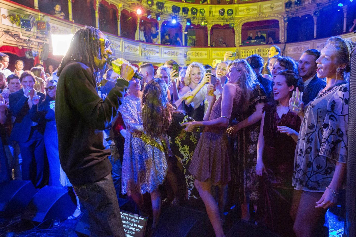Snoop Dogg with guests dancing at Barchannal shabbat dinner party at this Dubrovnik Wedding in Croatia | Photo by Robert Fairer