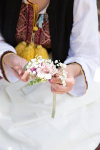 Flower decorating during Lokrum Island picnic at this Dubrovnik wedding in Croatia   Photo by Robert Fairer