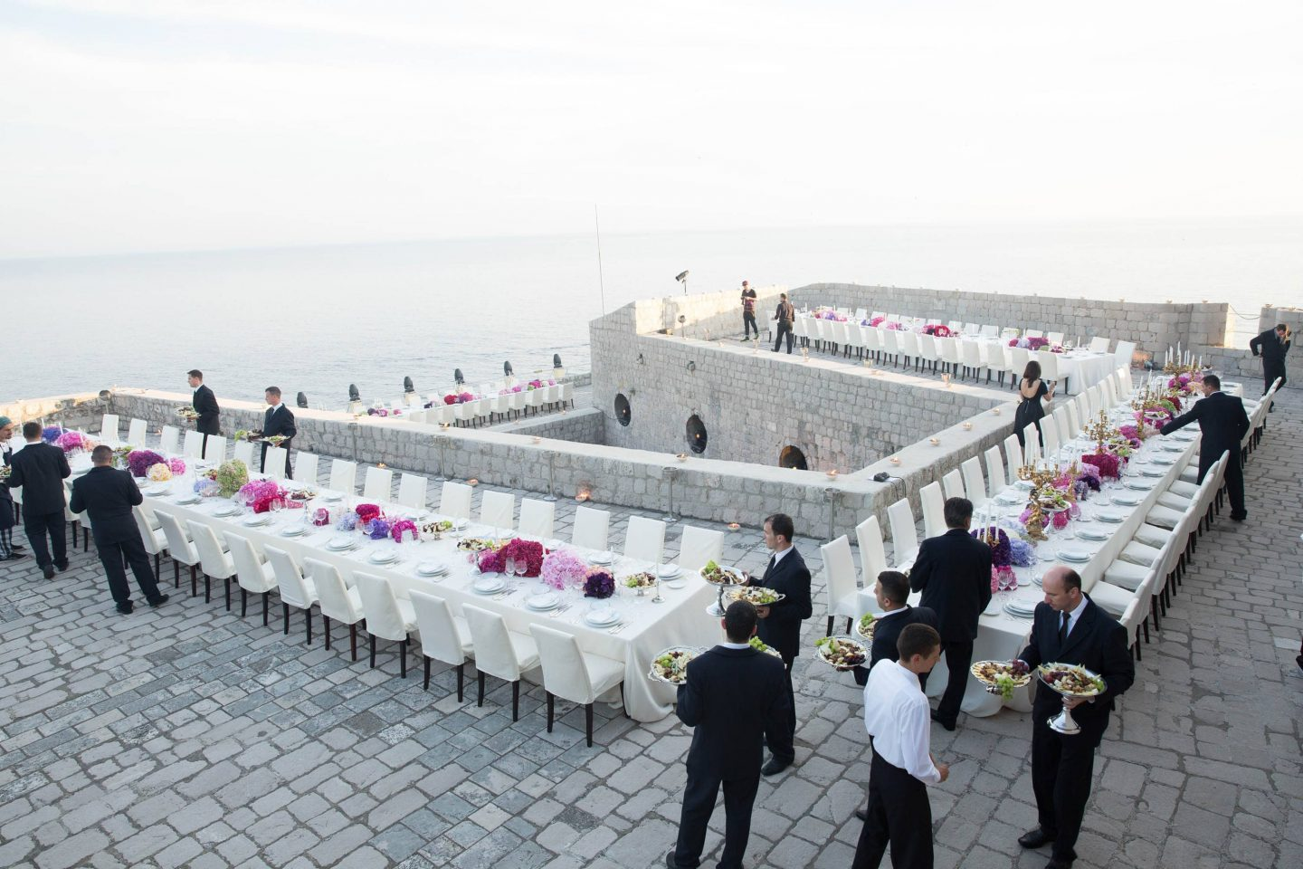 Evening dinner at Fort Lovrijenac at this Dubrovnik wedding in Croatia | Photo by Robert Fairer