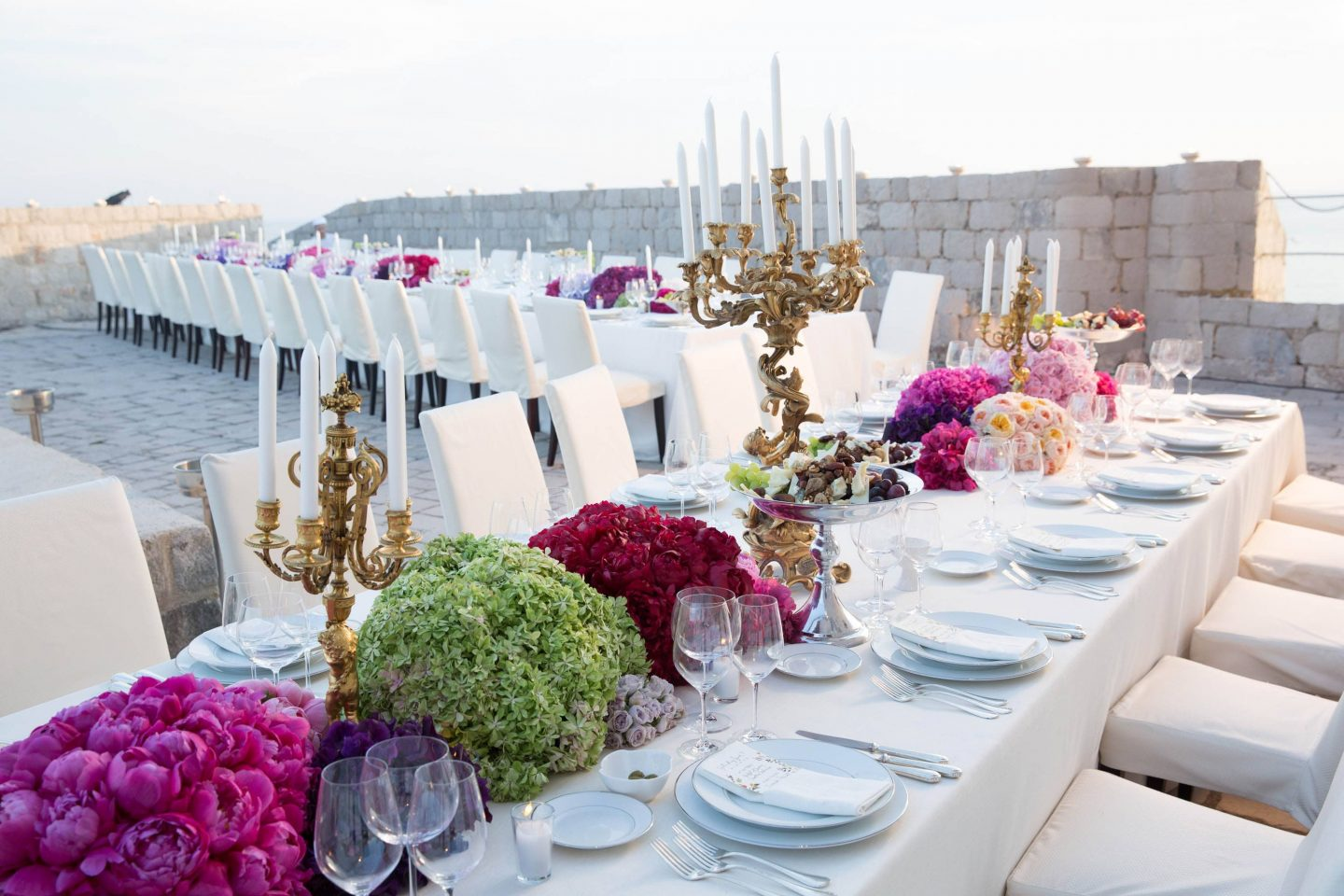 Evening dinner table decor at Fort Lovrijenac at this Dubrovnik wedding in Croatia | Photo by Robert Fairer