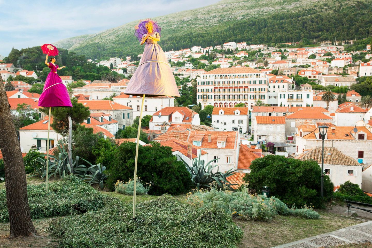 Women on stilts leading the way to Fort Lovrijenac at this Dubrovnik wedding in Croatia | Photo by Robert Fairer