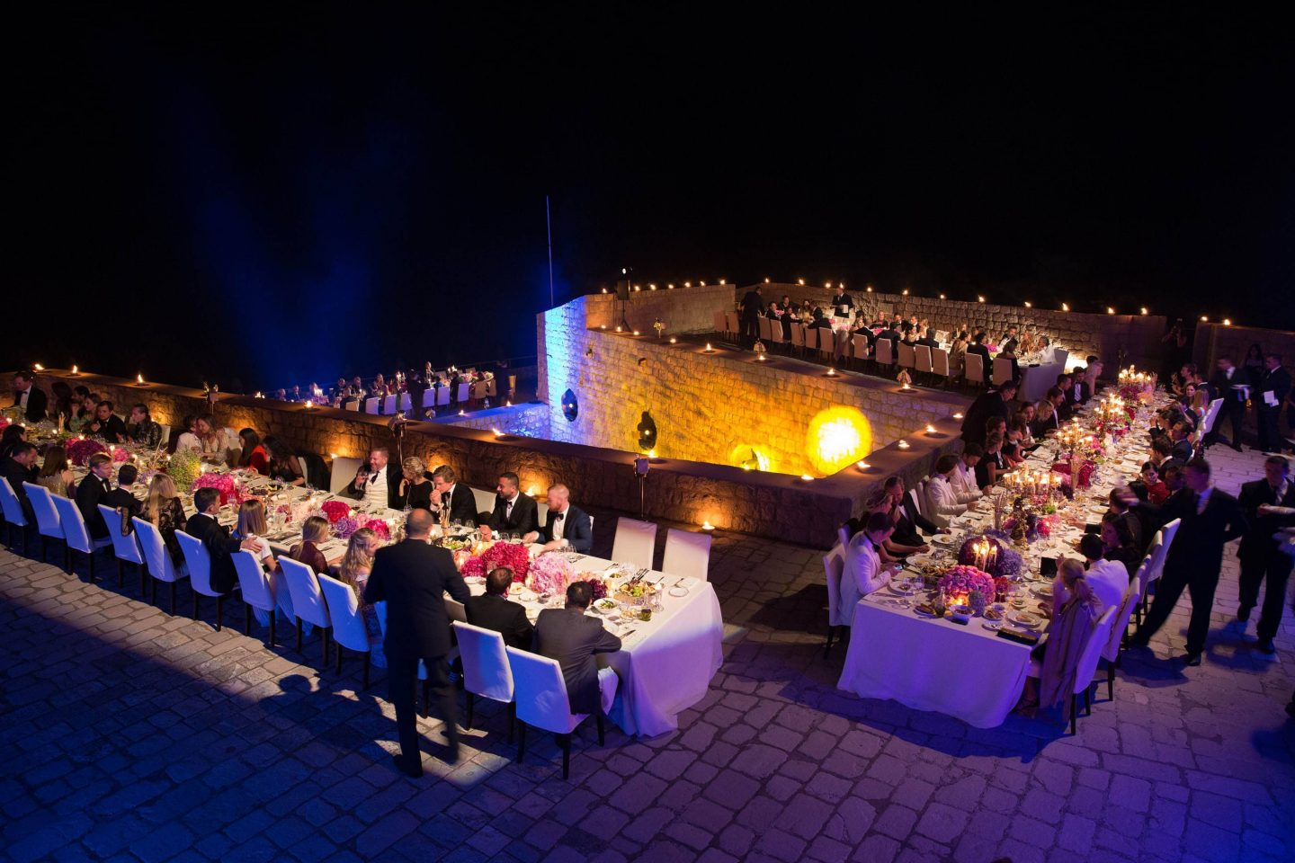 Guests during evening dinner party at Fort Lovrijenac at this Dubrovnik wedding in Croatia | Photo by Robert Fairer