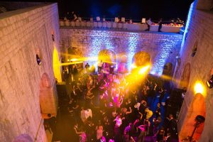 Evening dinner party dancing at Fort Lovrijenac at this Dubrovnik wedding in Croatia | Photo by Robert Fairer