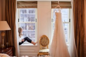 Bride getting ready at this classic autumn wedding at The Plaza in NYC | Photo by Christian Oth Studio
