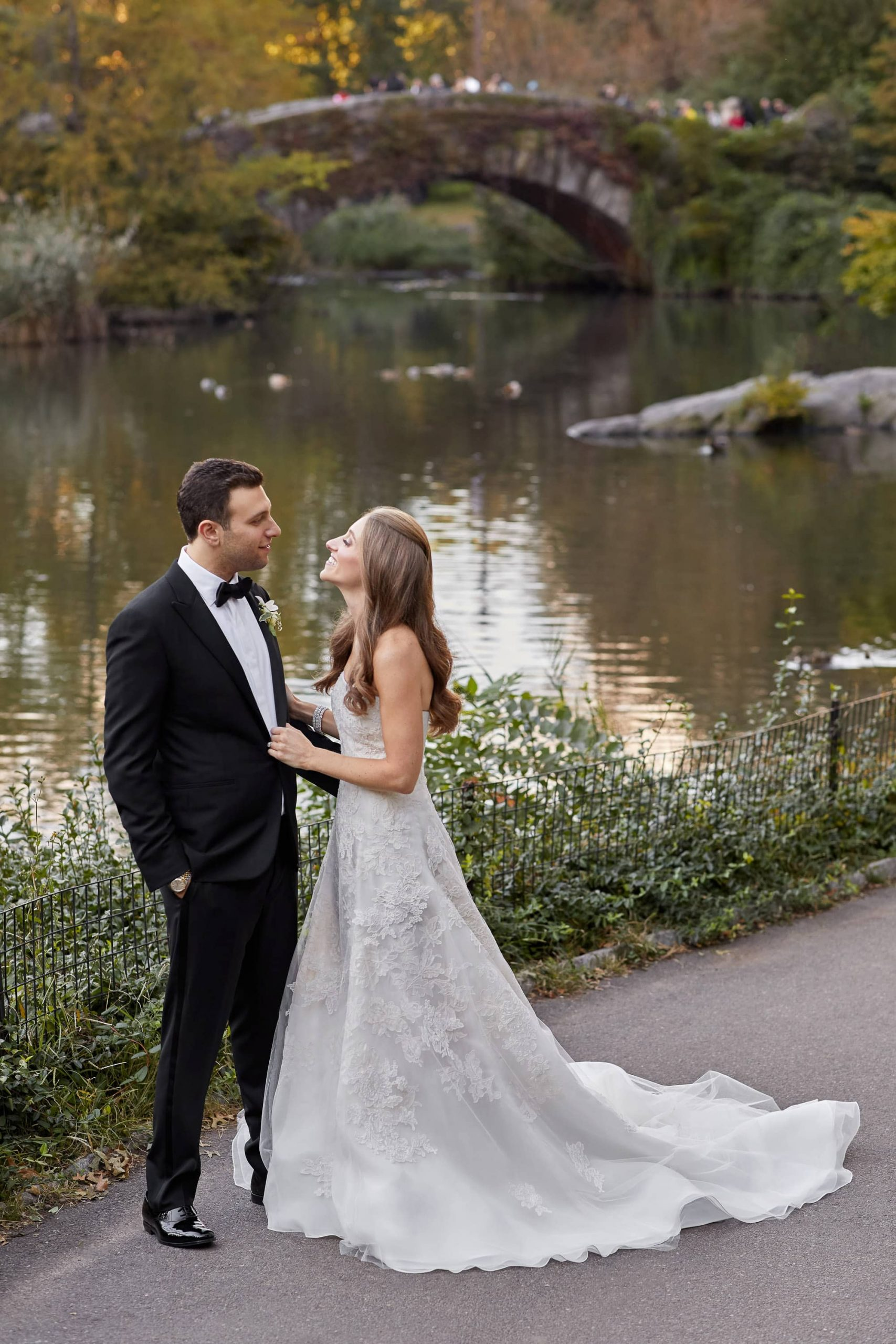Bride and groom at central park at this classic autumn wedding at The Plaza in NYC | Photo by Christian Oth Studio