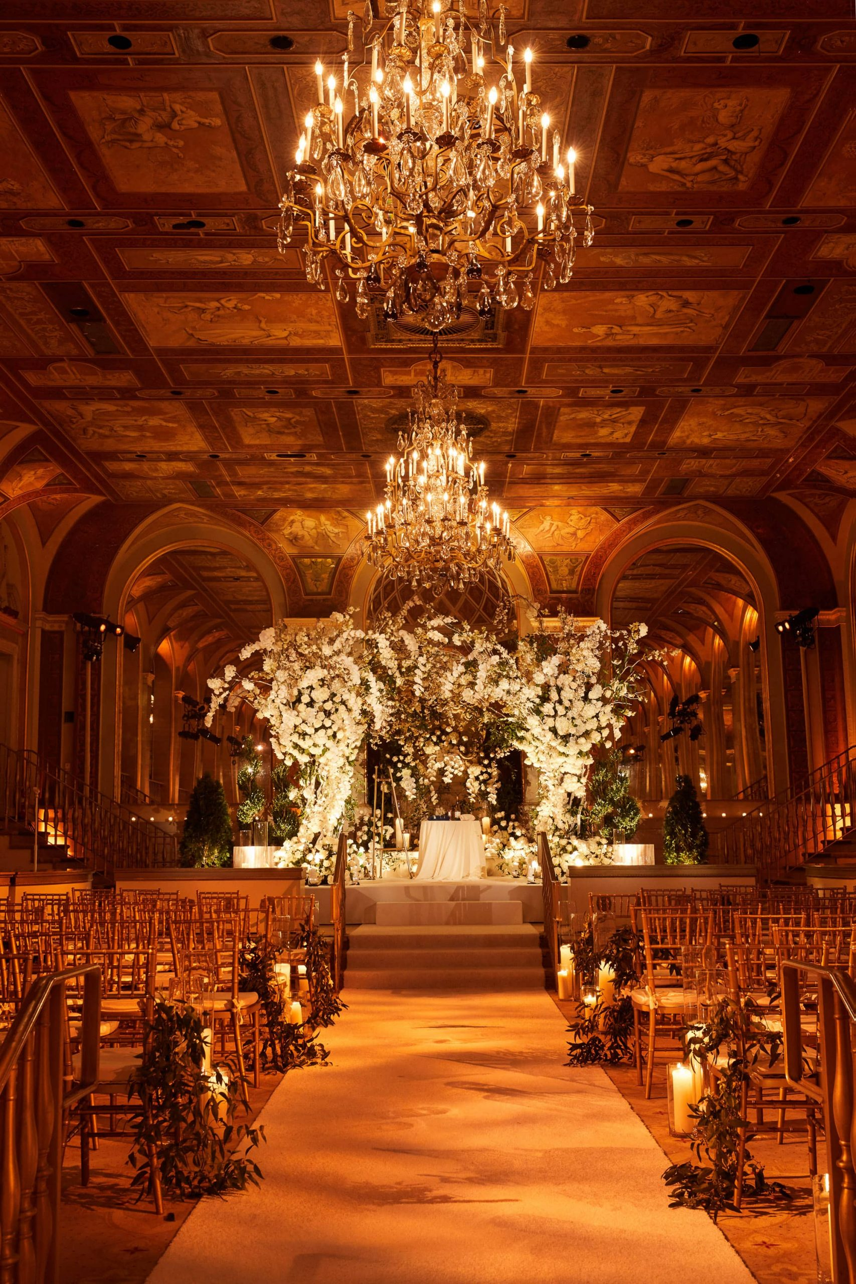 Ceremony with gorgeous floral chuppah designed by Ed Libby at this classic autumn wedding at The Plaza in NYC | Photo by Christian Oth Studio
