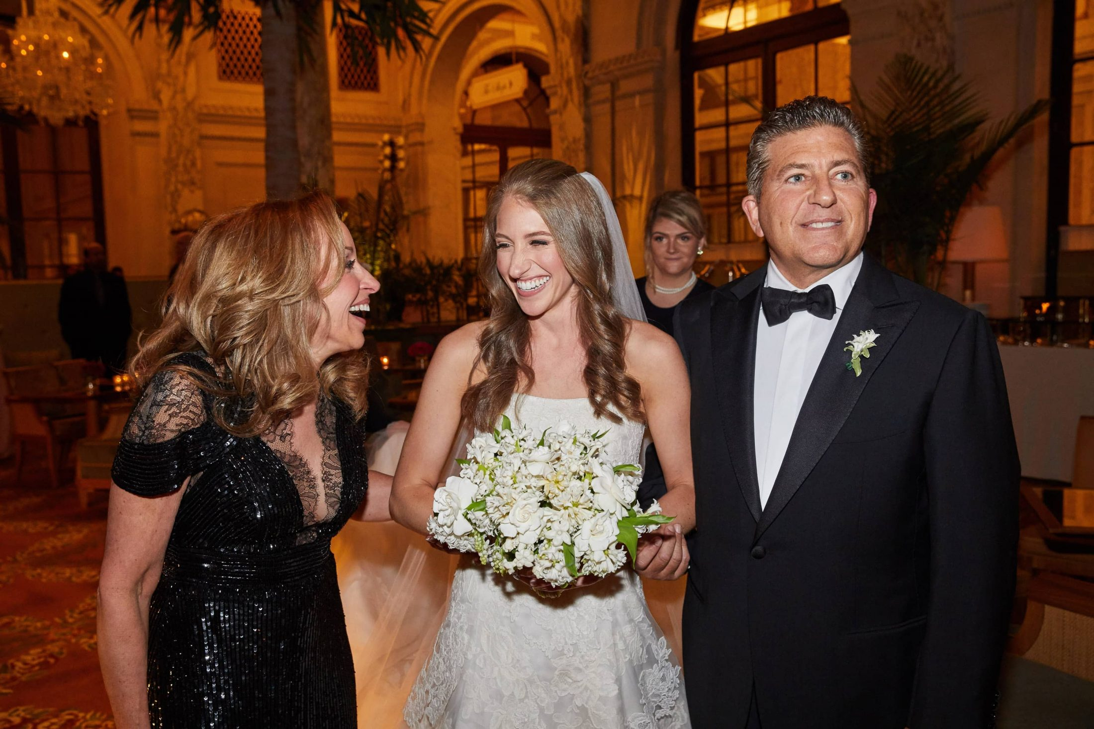 Bride and parents at this classic autumn wedding at The Plaza in NYC | Photo by Christian Oth Studio