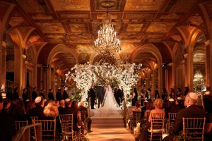 Ceremony with exquisite floral chuppah designed by Ed Libby at this classic autumn wedding at The Plaza in NYC | Photo by Christian Oth Studio