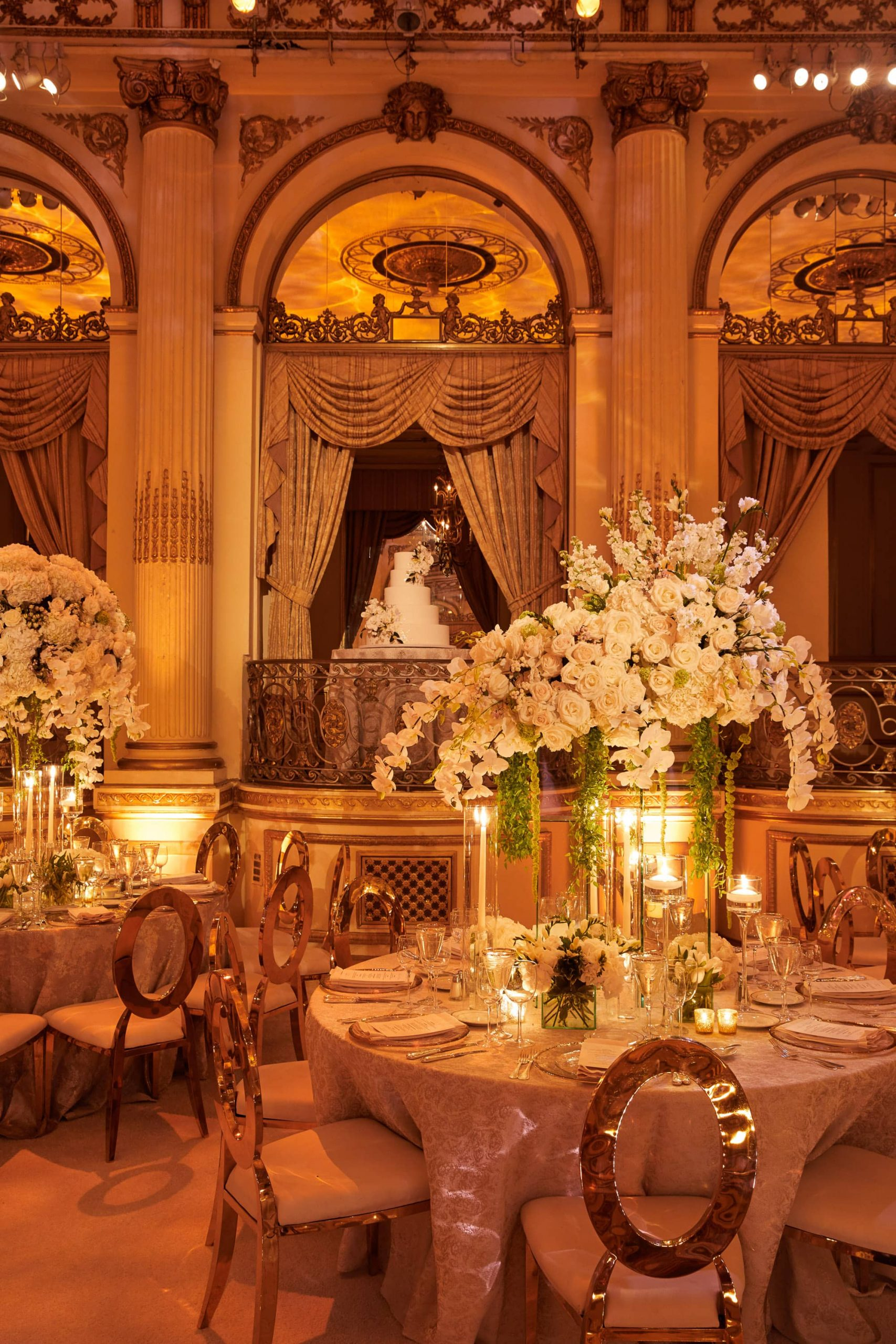Floral arrangements designed by Ed Libby at reception at this classic autumn wedding at The Plaza in NYC | Photo by Christian Oth Studio