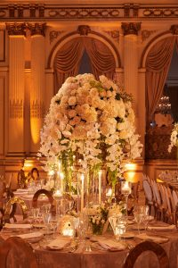 Floral arrangement designed by Ed Libby at gilded reception at this classic autumn wedding at The Plaza in NYC   Photo by Christian Oth Studio