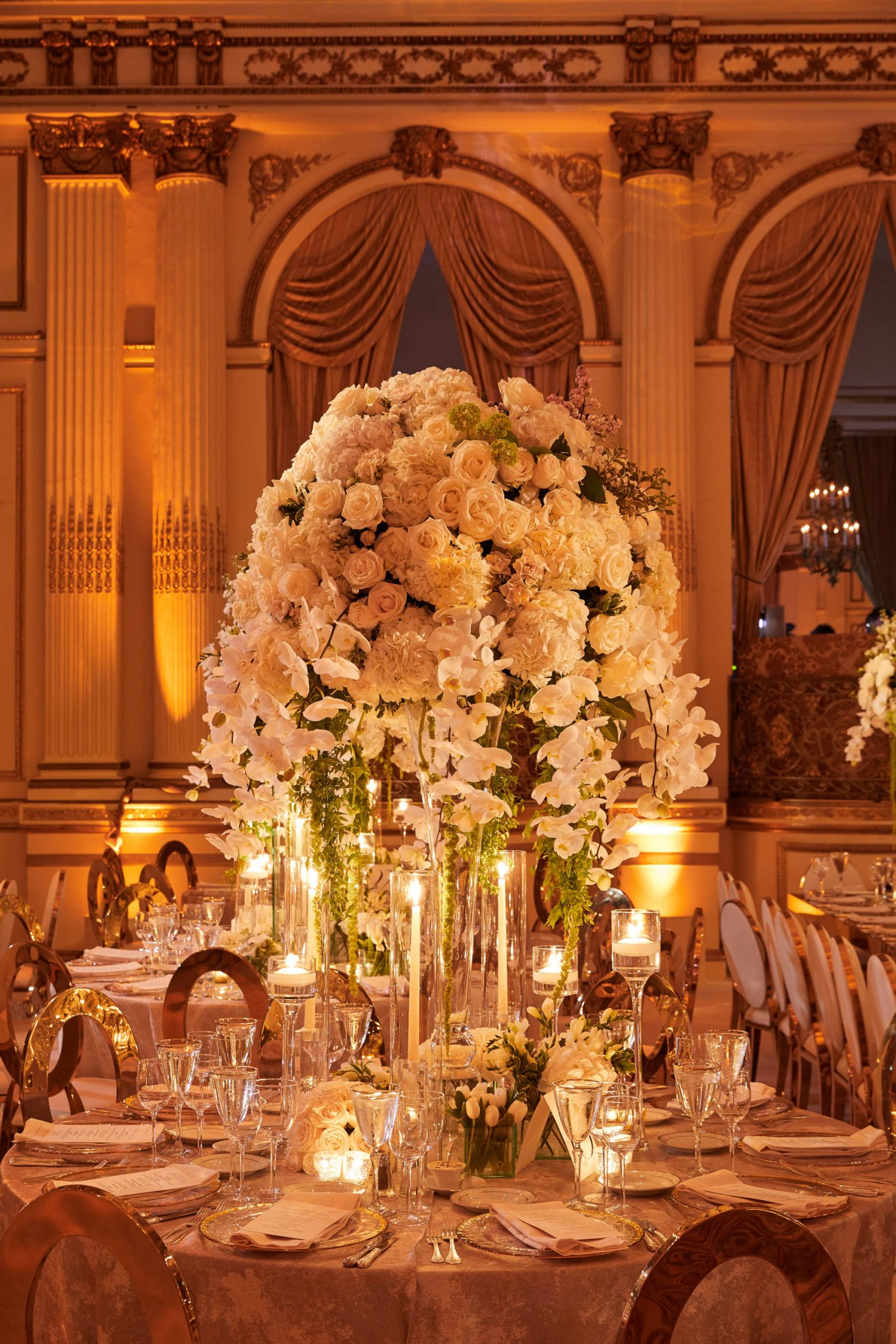 Floral arrangement designed by Ed Libby at gilded reception at this classic autumn wedding at The Plaza in NYC | Photo by Christian Oth Studio