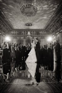 Bride and groom first dance atop mercury glass floor during reception at this classic autumn wedding at The Plaza in NYC | Photo by Christian Oth Studio