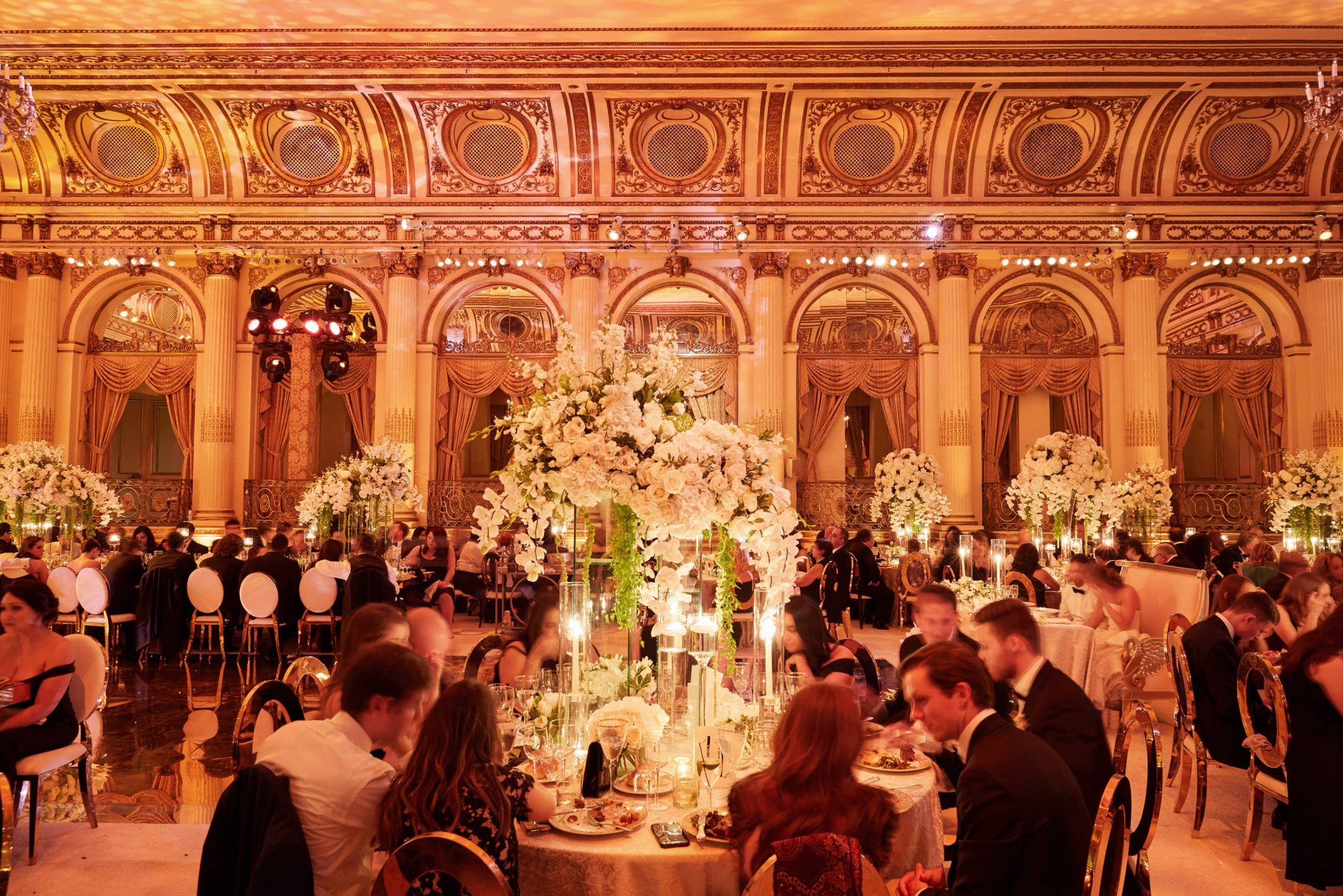 Guests dining during reception at this classic autumn wedding at The Plaza in NYC | Photo by Christian Oth Studio