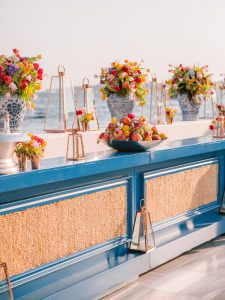 Floral decor at bright and colorful welcome party at this Istanbul wedding weekend at Four Seasons Bosphorus | Photo by Allan Zepeda