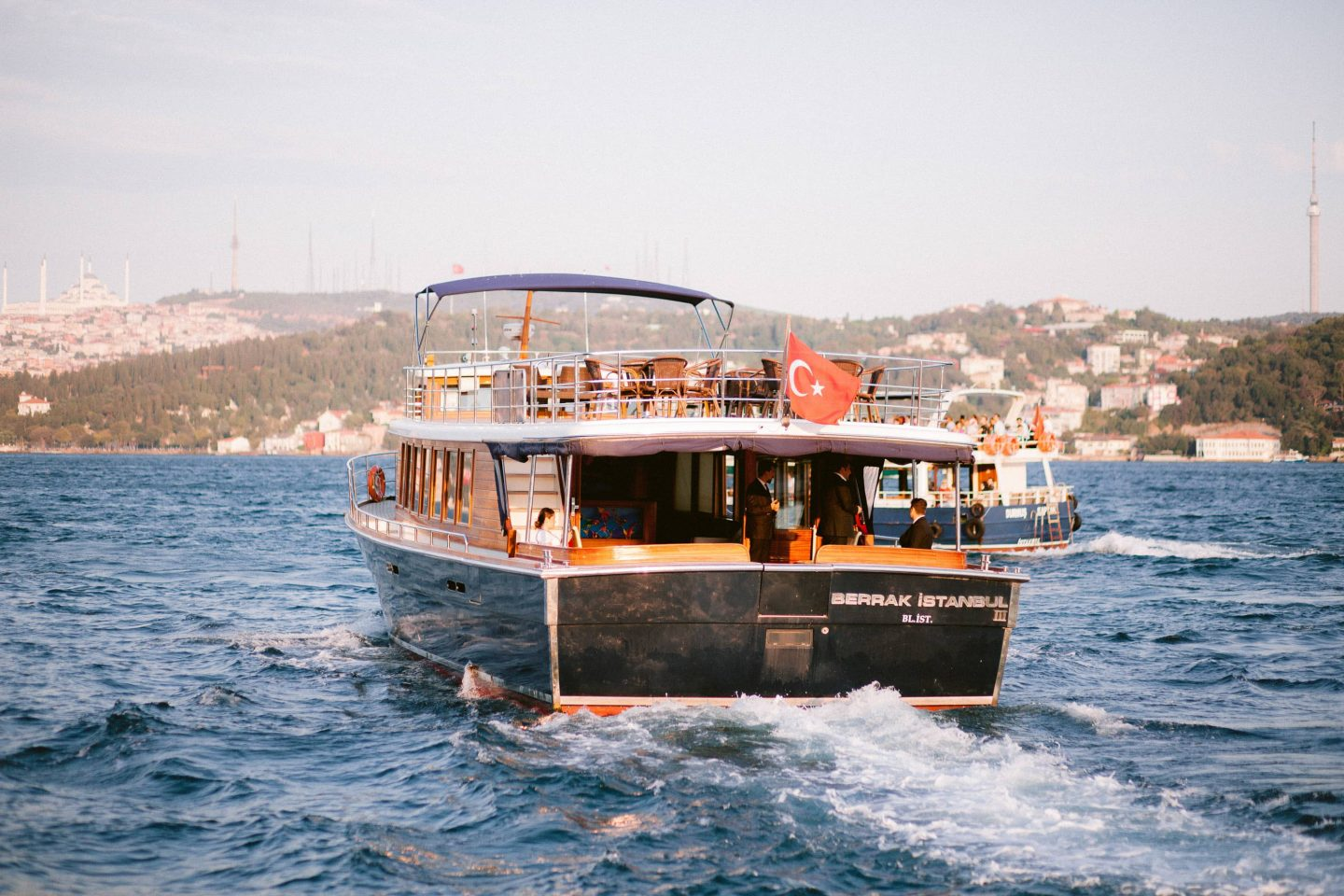Boat during sunset at this Istanbul wedding weekend at Four Seasons Bosphorus | Photo by Allan Zepeda