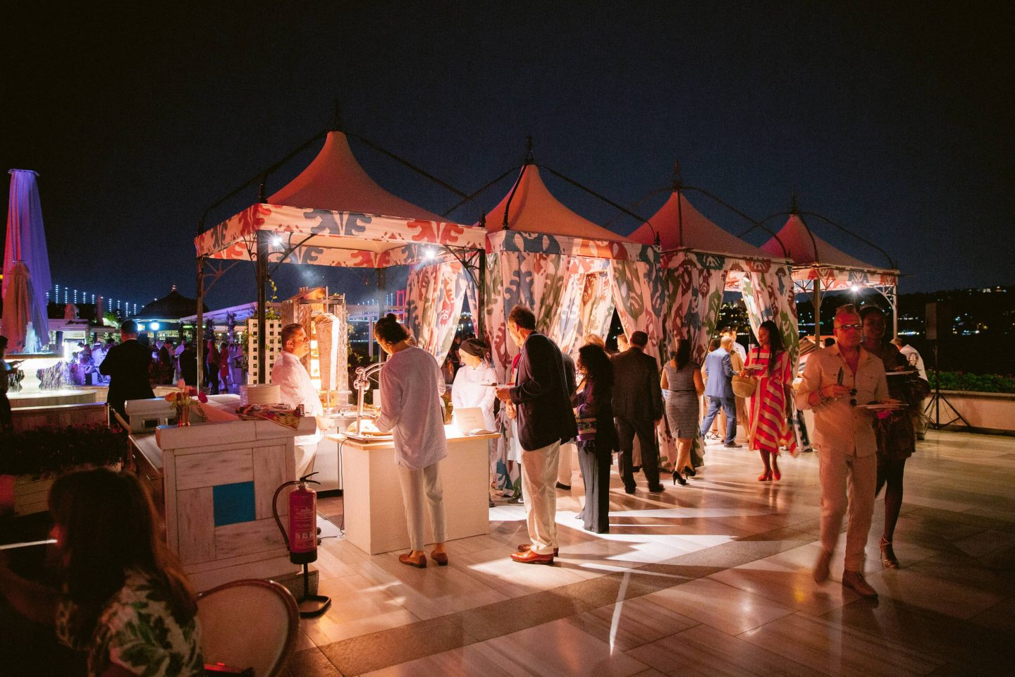 Food stands at the bright and colorful welcome party at this Istanbul wedding weekend at Four Seasons Bosphorus | Photo by Allan Zepeda