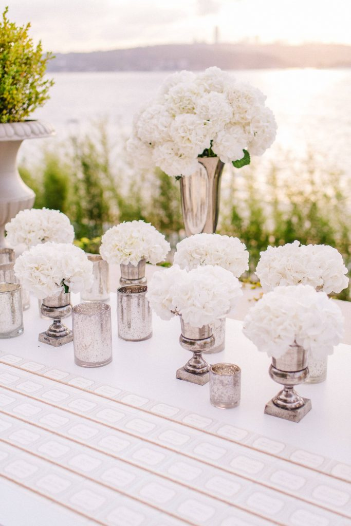 White party floral table decor at this Istanbul wedding weekend at Four Seasons Bosphorus | Photo by Allan Zepeda