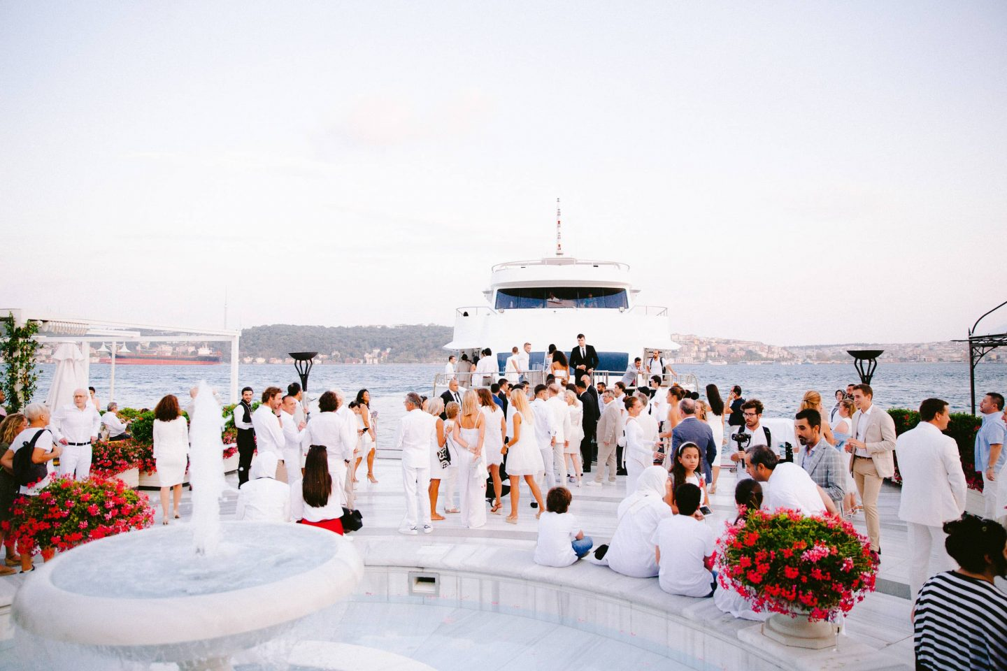 Guests during white party at this Istanbul wedding weekend at Four Seasons Bosphorus | Photo by Allan Zepeda