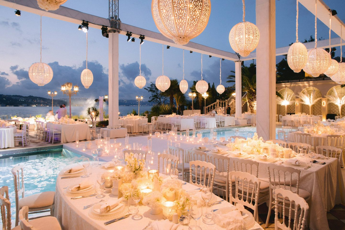 Nighttime white party decor at this Istanbul wedding weekend at Four Seasons Bosphorus | Photo by Allan Zepeda