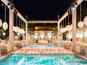Nighttime and pool decor for white party at this Istanbul wedding weekend at Four Seasons Bosphorus | Photo by Allan Zepeda