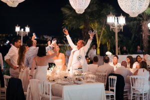 Guests during white party decor at this Istanbul wedding weekend at Four Seasons Bosphorus | Photo by Allan Zepeda