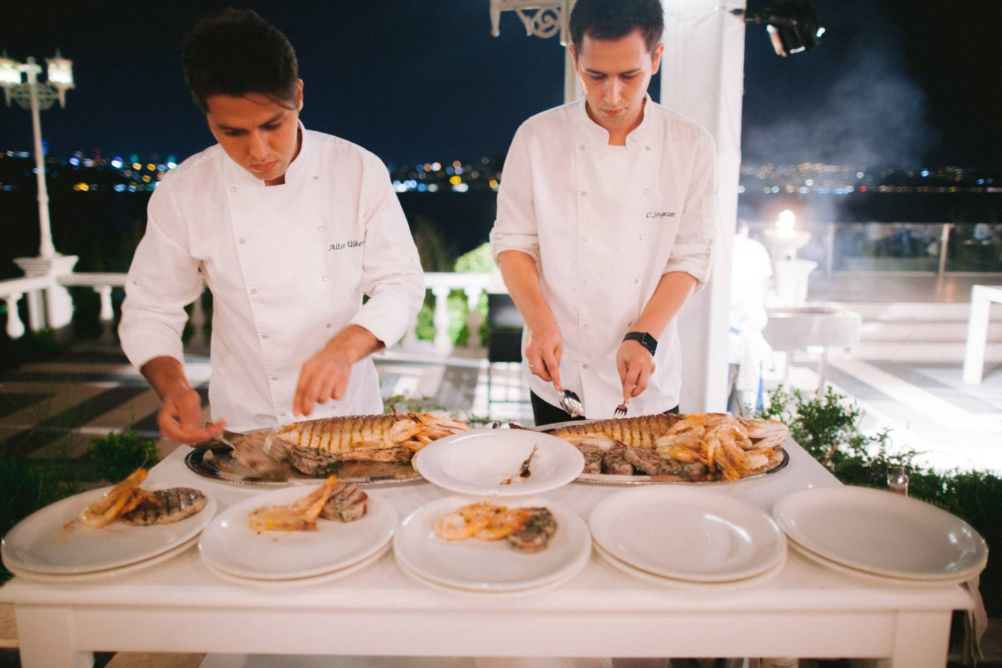 Chefs serving food at white party at this Istanbul wedding weekend at Four Seasons Bosphorus | Photo by Allan Zepeda