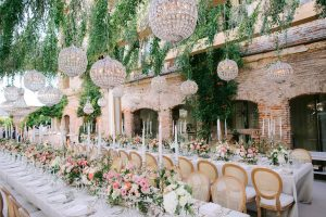 Reception under a garden-inspired pergola beset with taper candles and pink florals at this Istanbul wedding weekend at Four Seasons Bosphorus | Photo by Allan Zepeda