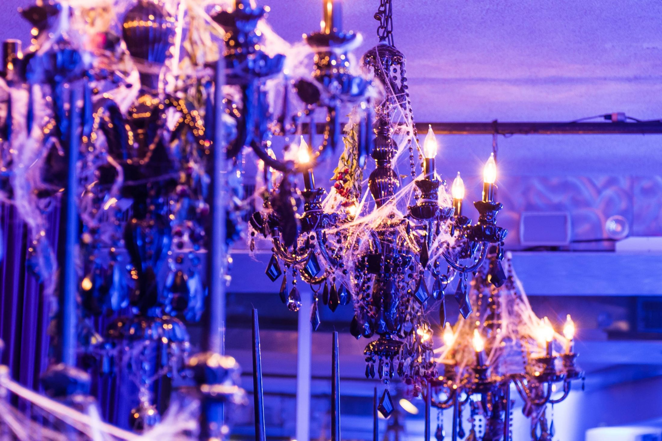 Cobwebbed black chandeliers at this epic halloween party at The Standard in NYC | Photo by Gruber Photographers