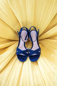 Something blue -- the bride's shoes at this Hamptons wedding weekend held at The Parrish Museum | Photo by Roey Yohai Studio