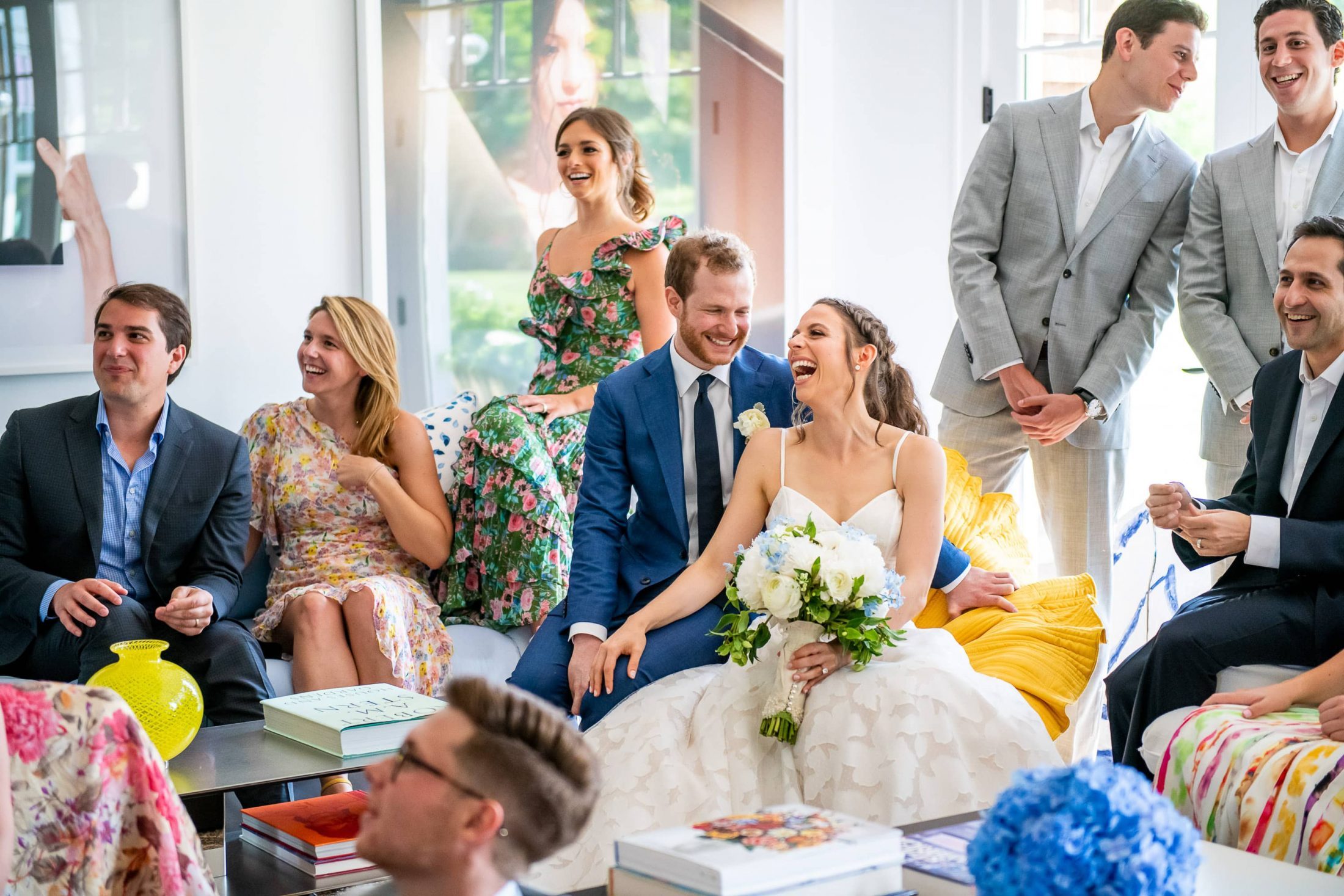 Bride and groom with family and friends at this Hamptons wedding weekend held at The Parrish Museum | Photo by Roey Yohai Studio