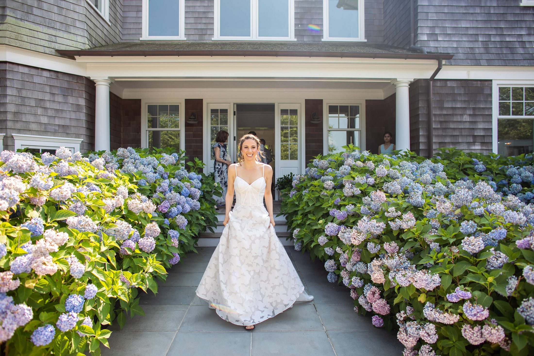 Bride surrounded by hydrangeas at this Hamptons wedding weekend held at The Parrish Museum | Photo by Roey Yohai Studio