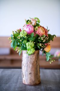 Floral table decor at this Hamptons wedding weekend held at The Parrish Museum   Photo by Roey Yohai Studio